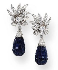 A PAIR OF INVISIBLY-SET SAPPHIRE AND DIAMOND EAR PENDANTS, BY VAN CLEEF & ARPELS Each detachable pendant designed as an invisibly-set sapphire and pavé-set diamond drop, suspended by a circular-cut diamond from a foliate cluster of circular-cut diamonds, mounted in platinum Signed Van Cleef & Arpels, N.Y., No. 38497