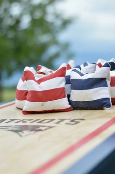 Make your own cornhole bags with inexpensive supplies and basic sewing skills. This is a great backyard game for the whole family. #cornhole #backyardgame