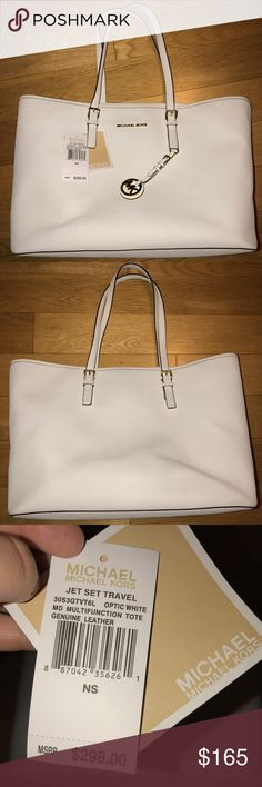 """Michael Kors Jet Set Saffiano tote Michael Kors Jet Set Saffiano tote in white. Saffiano Leather; Gold tone hardware Measures 15 X 11 X 6"""" Handle Drop: 8.5"""" Interior: 1 Interior Zip Pocket, 3 Open Pockets, And 1 Padded Zipper Divider that can fit some laptops This bag is in used good condition. Since the bag is white there are some marks on the inside and outside but all in all it's in good shape. I had used this for school but now I have no need for it so I'm trying to find it a new home…"""