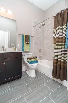 Porcelain tile shower with gray silk tile on floor. 2422 S. Floors And More, Porcelain Tile, Corner Bathtub, Backsplash, Townhouse, Flooring, Shower, Silk, Gray