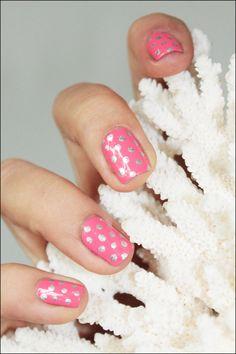 silver polka dots on pink nails