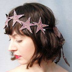This celestial beauty is made from 6 handcut stars, delicately sewn to Fancy Felt, then doused in Rainbow glass glitter.