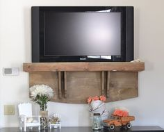 how s your tv hanging we added a shelf now ours looks better, diy, shelving ideas, woodworking projects, Summer display