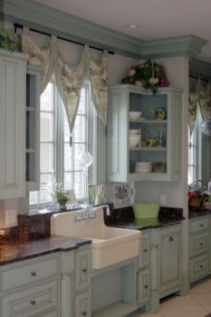 """Shabby Chic Kitchen Idea: Don't you just love this Shabby Chic Style Kitchen? It shows the use of one of the great """"Shabby Chic"""" colors with lots of cottage appeal. The farmhouse sink is a great vintage style accent. Notice also the use of floral fabrics for the window treatments."""