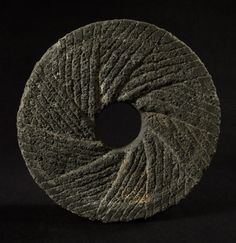 millstone of volcanic rockattributed toSouth Seas