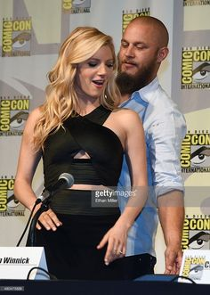 Actor Travis Fimmel (L) pulls a chair out for actress actress Katheryn Winnick as they arrive at a panel for the History series 'Vikings' during Comic-Con International 2015 at the San Diego Convention Center on July 10, 2015 in San Diego, California.
