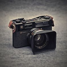 Yashica Electro 35 GTN w/ Square Hood.  My first 35mm camera.  Would love to find another.