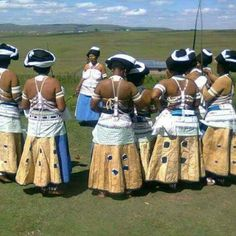 Xhosa married womens' dance or umngqunkqo, Eastern Cape, South Africa. These ladies are wearing traditional sheepskin skirts decorated with animal fur patches and bead work. Xhosa Attire, African Attire, African Wear, African Women, African Dress, African Traditional Wear, Traditional Fashion, Traditional Outfits, African Fashion Designers