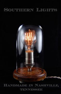 Great designer...check out his stuff!!  Vintage bell jar table lamp with cloth covered cord by-- adam gatchel