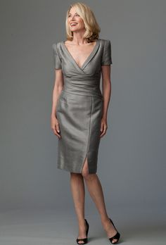 Brides: Siri. This very tailored dress is modernized with a structured sleeve, diagonal folds at the waist and a front slit. Made in USA.