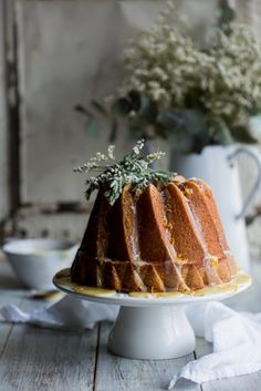 Blood Orange & Olive Oil Bundt Cake | Cygnet Kitchen - Light sponge cake made with olive oil and blood orange juice, drizzled with a white chocolate glaze, topped with sugared rosemary.