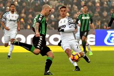 """Juventus' forward from Argentina Paulo Dybala (R) fights for the ball with Sassuolo's defender from Italy Paolo Cannavaro during the Italian Serie A football match Sassuolo vs Juventus at """"Mapei Stadium"""" in Reggio Emilia  on January 29, 2017.  A / AFP / GIUSEPPE CACACE"""