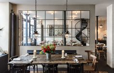 """wanted to liberate good French food from expensive hotel dining rooms,"""" young chef Bertrand Grébaut, whose three-year-old restaurant Septime is one of the most sought-after reservations in Paris, told The New York Times. - Where to Eat in Paris Photos Architectural Digest, Cafe Restaurant, Restaurant Design, Best Restaurants In Paris, Sweet Home, Dining Table, Dining Rooms, Fine Dining, Windows"""