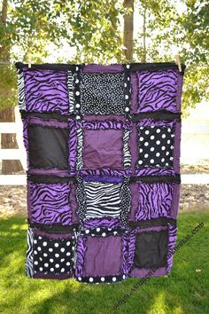 This is a fun purple black, and zebra print flannel pattern and cotton rag quilt. Perfect for your baby girl and a great size for a crib, throw, or baby blanket. The blanket is Rag Quilt Purple, Girls Rag Quilt, Baby Girl Purple, Purple Zebra, Color Lila, Baby Zebra, Quilts For Sale, Baby Girl Blankets, Crib Bedding