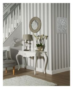 This beautiful Glitterati Stripe Glitter Wallpaper by Arthouse features a wide vertical platinum silver stripe that has an embossed texture and is infused with subtle silver glitter. This alternates with a contrasting matte white stripe. Easy to apply, this high quality non-woven vinyl wallpaper would look great as a feature wall or equally good when used to decorate a whole room. Why not coordinate with another complimentary design from the Glitterati range to complete the look of your…