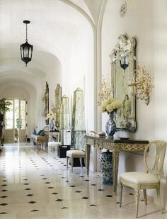 Beautiful hall with blue and white porcelain - Dallas Home - Interior Design by Beverly Field, Veranda Jan-Feb 2014