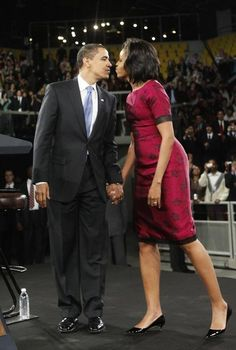 Pres. & First Lady Obama sharing some warm love.