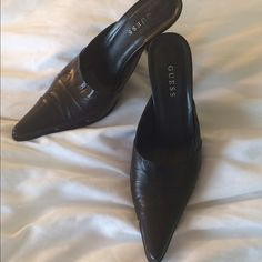 Guess heels In good, worn condition. Size 9. Black. Please note: these shoes are not a good fit if you have a wide foot (as I learned the hard way after my sister gave them to me) :/ Guess Shoes Heels