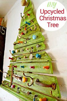 How to make a fun unique DIY wooden Christmas tree. Upcycled from scrap wood such as moldings and pallets combined with old knobs and hooks. Perhaps arrange knobs & hooks to hang ornaments on them Decoration Christmas, Wooden Christmas Trees, Christmas Signs, Christmas Projects, Holiday Crafts, Vintage Christmas, Christmas Crafts, Christmas Ornaments, Recycled Christmas Tree