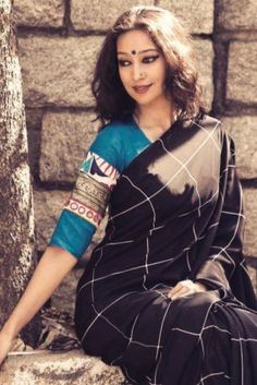 Black Checks Saree with vintage look is from Calantha Wardrobe. The white checks are giving elegant look to the saree and paired with elbow sleeves blouse Indian Blouse, Indian Sarees, Beautiful Blouses, Beautiful Saree, Indian Attire, Indian Outfits, Indian Wear, Trendy Sarees, Simple Sarees