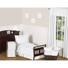 Toddlers can share their parents' contemporary style with this white toddler bedding set. The solid white, 100 percent cotton set matches any decor, and includes a lightweight comforter, standard pillow sham, pillowcase, and fitted and flat sheets.