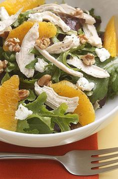 Orange segments, toasted walnuts and tangy goat cheese brighten up this simple salad. Try this salad for a take-along lunch. To keep the salad greens from getting soggy, pack the greens, salad toppings and dressing in separate containers and toss them together just before eating. #salads #saladrecipes #healthysalads #saladideas #healthyrecipes