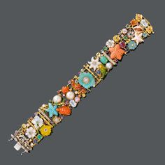ENAMEL AND MULTICOLOUR GEMSTONES BRACELET, BY SANTAGOSTINO. Yellow and white gold 750, 77g. Designed with sea-animals and flower motifs such as starfish, sea horse, turtle, shell and fish, set with corals, turquoise, mother of pearl, chalcedony, sapphires, rubies, emeralds, aquamarines, topaz, pearls, enamel and diamonds. W ca. 2,2 cm, L ca. 17,5 cm.