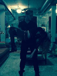 Jace carrying Clary, shooting a scene,