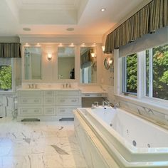 Love the luxurious look of marble in a bathroom. If marble is out of your budge, you can also go with marble-look porcelain tile.