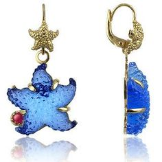 Tagliamonte Marina Collection - Blue Starfish Rubie & 18K Gold Earrings These translucent 18K gold earrings are an exclusive hand-made creation. The starfish are made in 18K gold and blue vitreous paste with cabochon rubies on the sides. Made in Italy. $2100.00