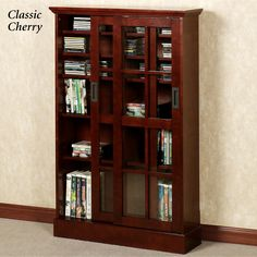 Display And Store Your Collection In The Malcolm Media Cabinet. This Wooden  Organizer Has Six Shelves Enclosed Behind Glass Doors For Easy Access To  Your.