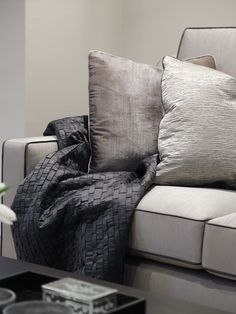 luxurious cushions and throw in soft shades of grey and mulberry | Boscolo - Detached Family Home - Living Room