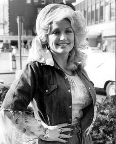 19 of Dolly Parton's Most Fanciful Sleeves: There are these sheer, scalloped sleeves peeking out from a cutoff denim jacket. Double-sleeved goodness!