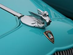 Vintage aqua car with winged goddess on the front? Yes please! 1933 Plymouth Coupe Hood ornament