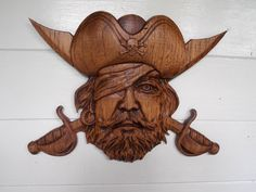 We specialize in 3D Wooden Pirate Wall Art including a pirate hat with crossed swords wood carving wall hanging perfect for your Halloween/Pirate Hat wall décor! This very rustic, almost Gothic Pirate wall ornament is perfect for the avid Halloween decoration collector OR a special gift for that amazing yearly Halloween Party host.  #halloween #gothic #decor #pirate #woodcarving