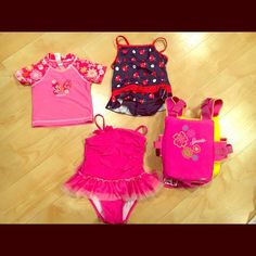 Little girl's swim BUNDLE Can be sold separately if desired. Clockwise: -pink rash guard (Oshkosh 18 months) -navy & red one piece (pink platinum 3T) -pink safety vest, UV50 (speedo 2-5 years) -pink tutu one piece (Circo 3T) See description Swim