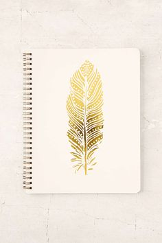 Feather Notebook- could use a metalic pen and draw this kind of thing on a plain notebook.