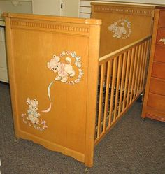wooden cribs with decals and plastic teething strips on the top of the side rails