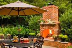 This handsome traditional brick fireplace with stone paver patio is the perfect place for dining al fresco.
