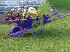 Old wheelbarrow spray paint a few plants and I have new flower bed ...