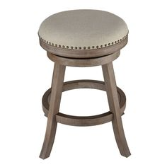 Features:  -Brass nailhead trim.  -Protective metal kick-plate.  -Seamless 360° swivel.  -Upholstered in a neutral linen fabric.  Frame Material: -Wood.  Base Color: -Weathered Brown.  Seat Material: