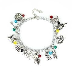Alice in Wonderland 11 Themed Charms Silvertone Metal Charm Bracelet ($7.94) ❤ liked on Polyvore featuring jewelry, bracelets, charm bracelet bangle, charm bracelet, charm jewelry, charm bangle and charm bracelet jewelry