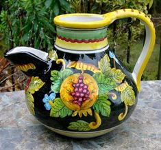 """This Italian ceramic pitcher is a beautiful way to serve iced tea, water or Sangria at the table. It will also double as a lovely centerpiece when filled with a colorful bunch of flowers. Hand painted exclusively for Poggi Bonsi in a family-run studio in Deruta, Italy--a village which is world-famous for the creation of Italian Majolica Pottery.    Size: 7.5"""" tall, 7"""" diameter at widest."""