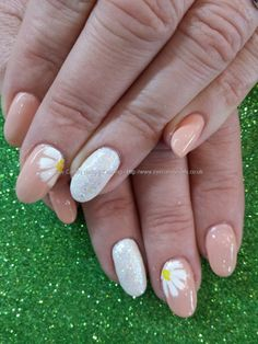 No 39 gel with white glitter and freehand flower nail art Taken at:3/21/2014 10:40:41 AM Uploaded at:3/21/2014 10:05:54 PM Technician:Elaine Moore