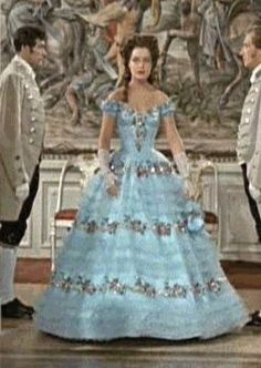 """Romy Schneider as Sissi entrance of the """"engagement"""" ball. The famous blue gown . """"Welcome, Lizl of Possenhofen"""" Impératrice Sissi, Fashion Dolls, Fashion Outfits, Fashion Styles, Women's Fashion, Hoop Skirt, Fairytale Dress, 18th Century Fashion, Elisabeth"""