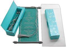 Scrolls in boxes. I seem to think of these as popular with East Coast Jewish weddings but then they started appearing absolutely everywhere. The trend covers the gamut from color to shape now, just be sure to proof-read the heck out of your order especially if it's done overseas (Mexico or in India).