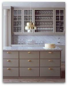 Kitchen design: grey kitchen with brass hardware, brass industrial pendant lamp, marble benchtops, display storage cbinets
