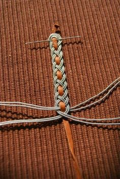 Silver wire braided around deerskin thong. Kobolds Kerkerbastelei