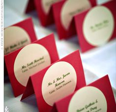 white favour box with red ribbon and heart embelishment matching