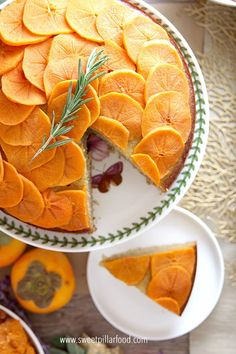 Persimmon Olive Oil Cake is the perfect way to use persimmons this season. Their beauty is showcased on top and their light sweet taste infuses this delicious cake. Middle Eastern Desserts, Olive Oil Cake, Cake Toppings, Fall Recipes, Holiday Recipes, Fruits And Veggies, Yummy Cakes, Fresh Fruit, Love Food